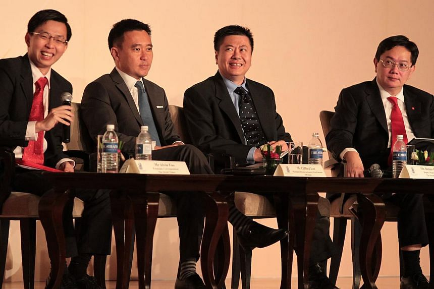 (From left) Mr Alvin Foo, Economics Correspondent at The Straits Times; Mr Clifford Lee, Managing Director and Head of Fixed Income at DBS Bank; Mr Dennis Chan, Deputy Money Editor, The Straits Times; Mr Philip Wee, a senior currency economist with D