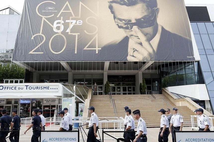 French police officers at the Cannes Film Festival on May 12. Security is being tightened in Cannes this year after a spate of increasingly audacious thefts highlighted the ease with which jewel thieves can strike. -- PHOTO: REUTERS