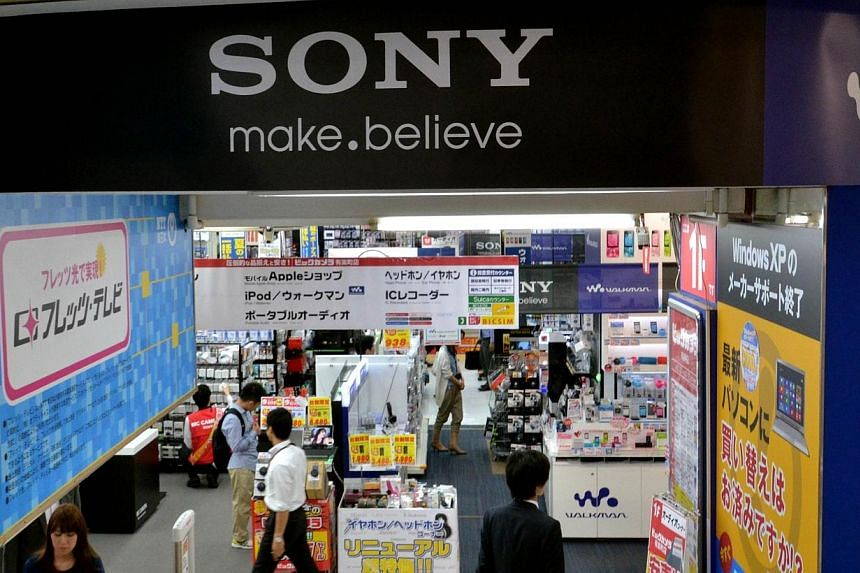 A logo of Japanese electronics giant Sony is displayed at a shop in Tokyo on May 13, 2014. Struggling electronics giant Sony will not pay bonuses to senior executives for the third straight year, the Japanese company said Tuesday, as it braces f