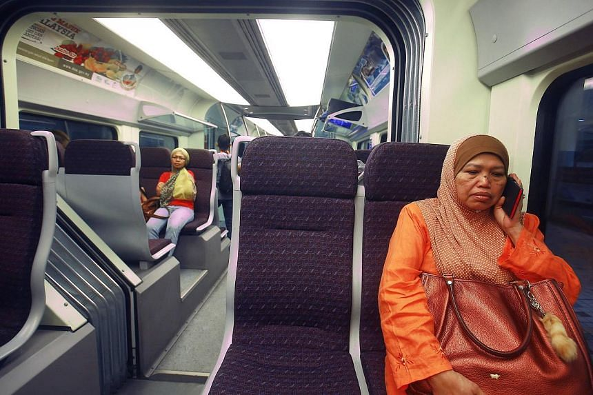 A woman sits inside the new Express Rail Link train enroute from KL Sentral to KLIA2 airport. Malaysia's Land Public Transport Commission plans to complete Phase 2A of the High-Speed Rail System connecting Kuala Lumpur and Singapore this year. -- FIL
