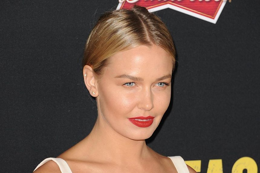 Lara Bingle, the model girlfriend of Australian Hollywood star Sam Worthington, was handed a suspended jail sentence on Tuesday for driving offences and was warned she is not above the law. -- PHOTO: AFP