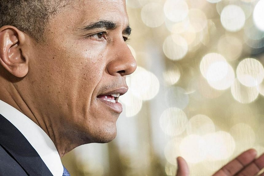 US President Barack Obama on Monday hailed India's massive general election and pledged to work closely with the next government in New Delhi. -- PHOTO: AFP