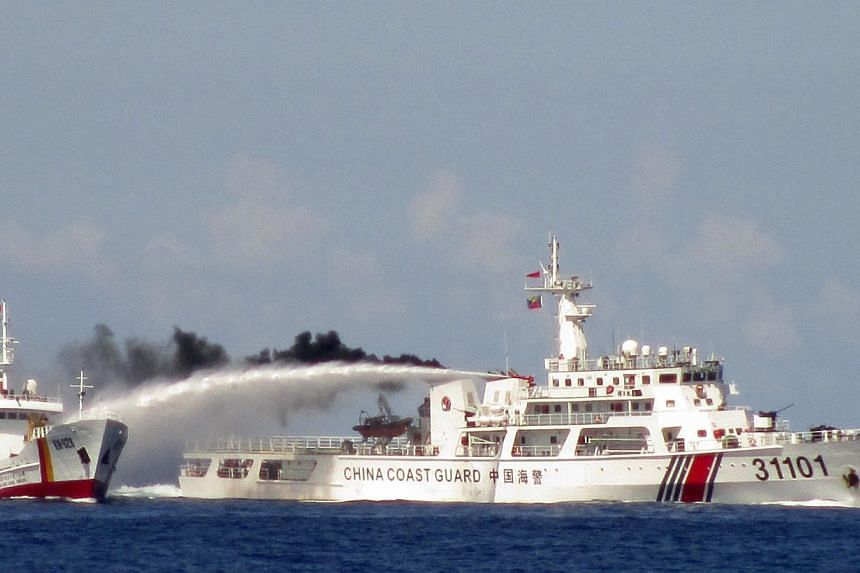 A Chinese ship (right) firing water cannon at a Vietnamese Sea Guard ship on the South China Sea, in this handout photo taken on May 3 and released by the Vietnamese Marine Guard on May 8. Such confrontations are contrary to China's promises of restr