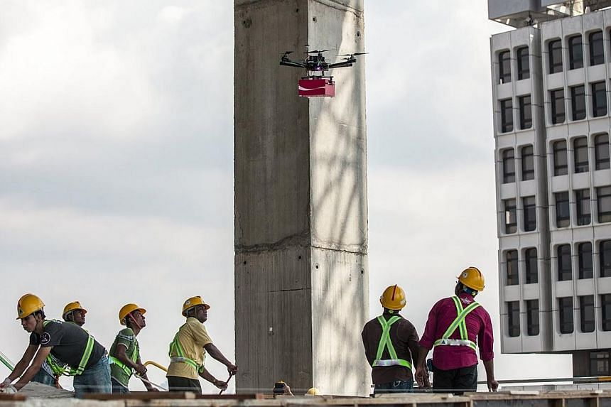 A drone delivering cans of Coca-Cola to construction workers at a high-rise work site. The cans carried handwritten notes from Singaporeans thanking the foreign workers for their labour.