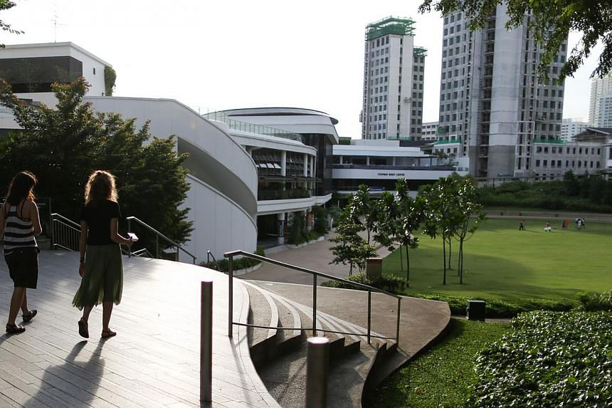 NUS (above) was rated No. 1 in Asia by a survey of over 8,000 graduate employers. This is the first time a Hong Kong institution has failed to top the QS table since 2009. -- ST PHOTO: ONG WEE JIN