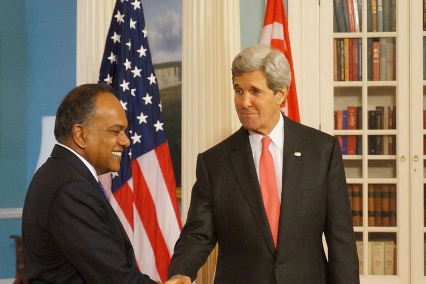 Singapore's Foreign Affairs Minister K. Shanmugam meets his US counterpart John Kerry at the State Department on the first day of his week-long visit to Washington. -- PHOTO: JEREMY AU YONG
