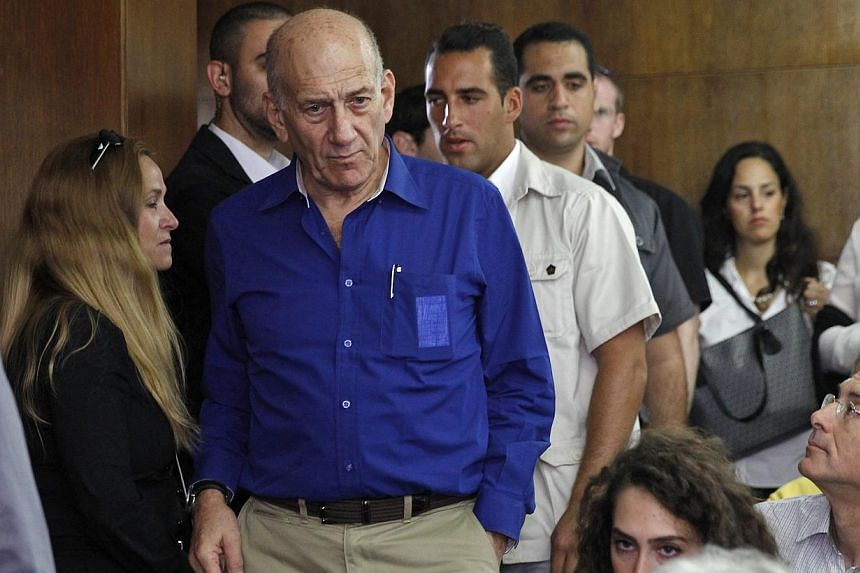 """Former Israeli Prime Minister Ehud Olmert (centre) arrives at the Tel Aviv District Court, in Tel Aviv, Israel, on May 13, 2014. Ehud Olmert was once described as """"probably the best"""" politician Israel had ever produced, but a major graft scandal has"""