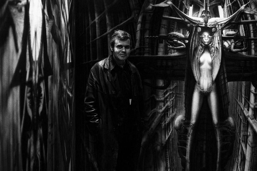 Swiss artist H. R. Giger standing with some of his artworks in Switzerland on Oct 29, 1981.-- FILE PHOTO: EPA