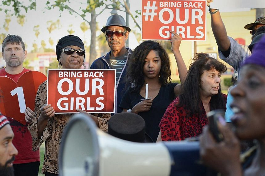 People participate in a Bring Back Our Girls campaign demonstration and candlelight vigil, held on Mother's Day in Los Angeles on May 11, 2014.Manned US aircraft were in the skies above Nigeria on Tuesday in the hunt for more than 200 missing s