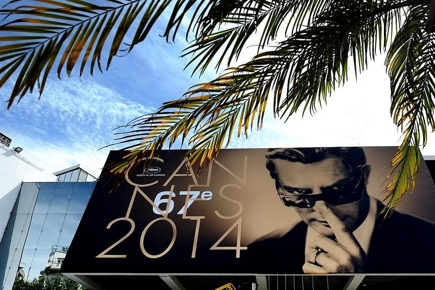 The Giant official poster of the 67th Cannes Film Festival, featuring Italian actor Marcello Mastroianni on May 12, 2014 on the facade of the Palais des festivals in Cannes, southeastern France. Cannes, one of the world's top film festivals, opens on