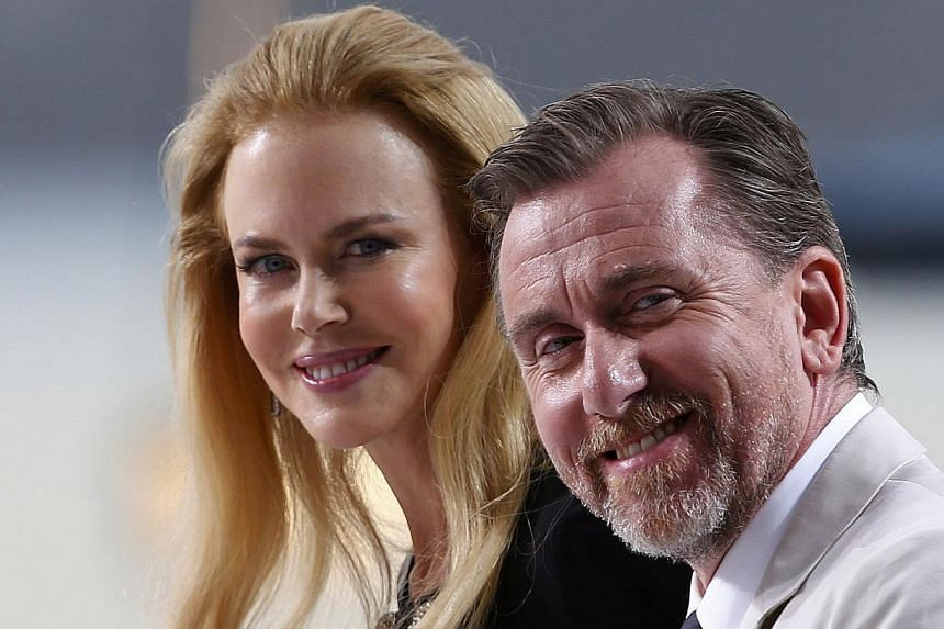 Actress Nicole Kidman (left) and actor Tim Roth are seen at the Grand Journal de Canal+ television studio on the Croisette on the eve of the opening of the 67th Cannes Film Festival in Cannes on May 13, 2014. -- PHOTO: REUTERS