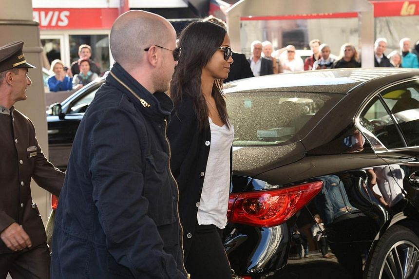 US actress Zoe Saldana (right) arrives at the Grand Hyatt Cannes Hotel Martinez on the eve of the 67th edition of the Cannes Film Festival in Cannes, southern France on May 13, 2014. -- PHOTO: AFP