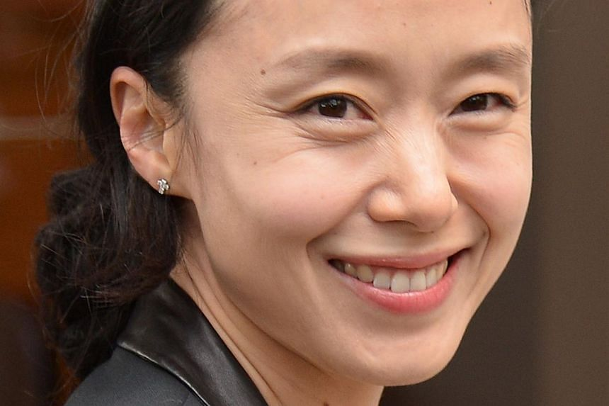 South Korean actress and member of the Feature films Jury, Jeon Do-yeon smiles as she arrives at the Grand Hyatt Cannes Hotel Martinez on the eve of the 67th edition of the Cannes Film Festival in Cannes, southern France on May 13, 2014. -- PHOTO: AF