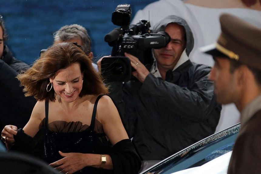 French actress and member of the Feature films Jury, Carole Bouquet smiles as she arrives at the Grand Hyatt Cannes Hotel Martinez on the eve of the 67th edition of the Cannes Film Festival in Cannes, southern France on May 13, 2014. -- PHOTO: AFP