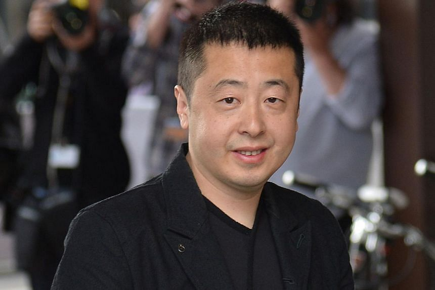 Chinese director and member of the Feature films Jury Jia Zhangke arrives at the Grand Hyatt Cannes Hotel Martinez on the eve of the 67th edition of the Cannes Film Festival in Cannes, southern France on May 13, 2014. -- PHOTO: AFP