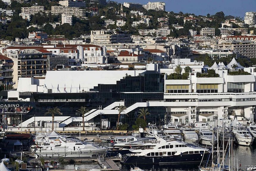 A general view shows the Festival Palace and the Port of Cannes on the eve of the opening of the 67th Cannes Film Festival in Cannes on May 13, 2014. -- PHOTO: REUTERS