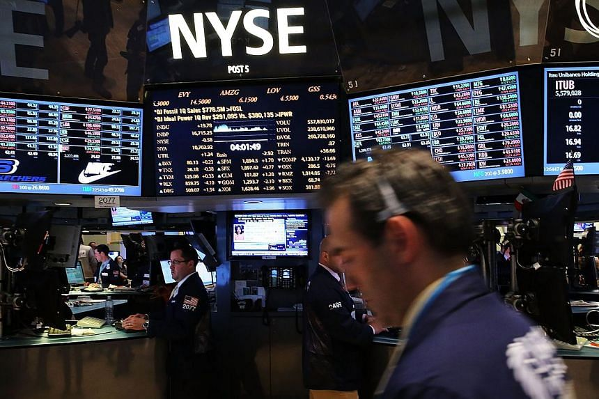 Traders work on the floor of the New York Stock Exchange on May 13, 2014 in New York City. -- PHOTO: AFP
