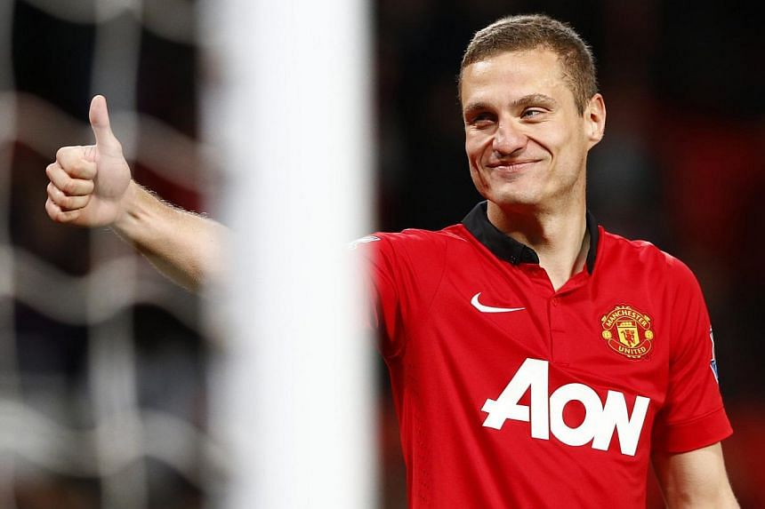 Departing Manchester United captain Nemanja Vidic (above) has denied the players failed to give their all for former manager David Moyes. -- FILE PHOTO: REUTERS