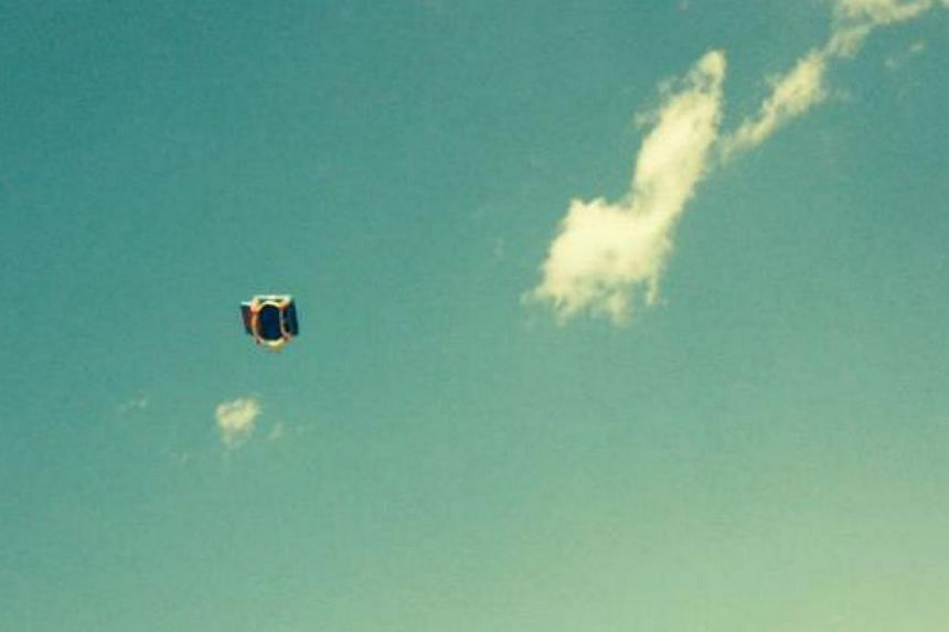 A witness' picture of a bounce house blowing through the air in South Glens Falls on Monday, well after children inside had fallen out. Three children were hurt, two seriously. -- PHOTO: POSTSTAR.COM/EMILY BOUCHER