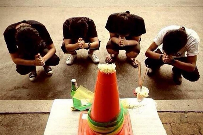 "A new term ""the holy cone"" went viral in Thailand this week. The orange traffic cone has become a symbol of frustration some Thais feel over their country's political turmoil. Twitter Photo: @tamdeedd"