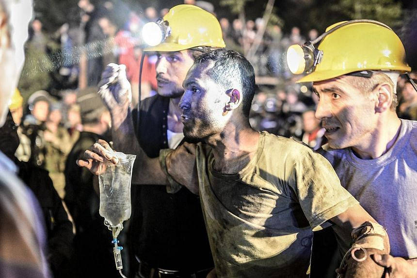 A miner came out helped by friends after an explosion in Manisa on May 13, 2014. -- PHOTO: AFP