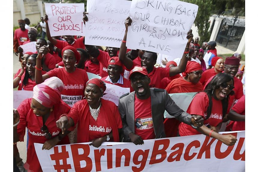 Nigerians take part in a protest demanding for the release of secondary school girls abducted from the remote village of Chibok, in Asokoro, Abuja on May 13, 2014. -- PHOTO: REUTERS