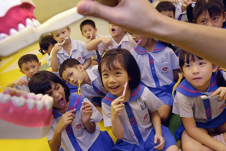Kindergarten students in PCF Paya Lebar Education Centre get a lesson on the correct way to brush their teeth by a dental therapist from the Health Promotion Board. Bad teeth is an increasing problem among young children here, with at