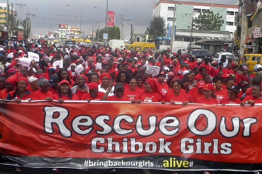 Nigerian members of the women's wing of All Progessive Party (APC) protest over the government's failure to rescue the abducted Chibok school girls in Lagos, Nigeria, on May 13, 2014. More than 200 schoolgirls on Wednesday began their second month as