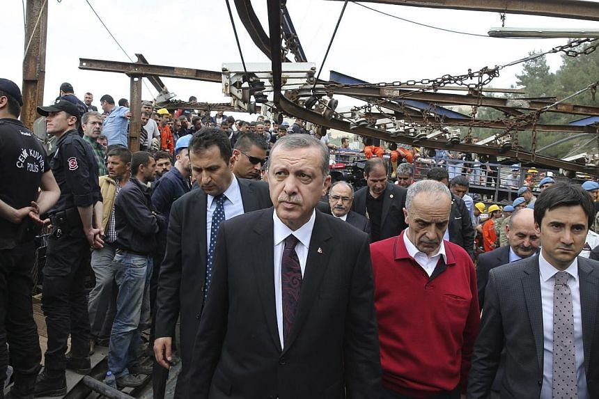 Turkey's Prime Minister Tayyip Erdogan (centre) visits the coal mine accident site in Soma, a district in Turkey's western province of Manisa, on May 14, 2014. -- PHOTO: REUTERS