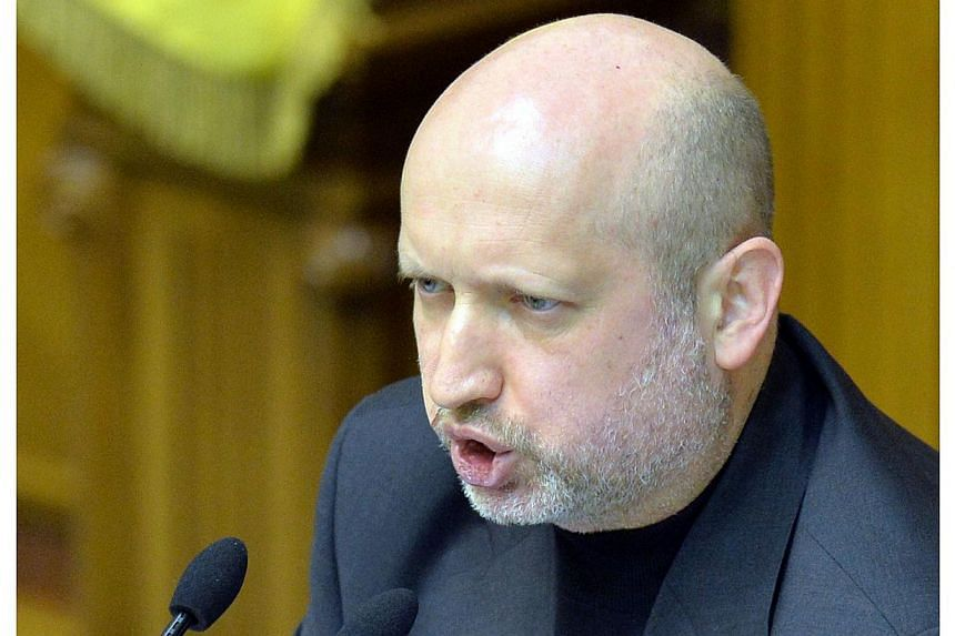 Interim President Oleksandr Turchynov said on Wednesday as he opened round-table talks on Ukraine's deepening crisis that Kiev was ready to listen to pro-Russian rebels in the east but would not bow to blackmail. -- FILE PHOTO: AFP