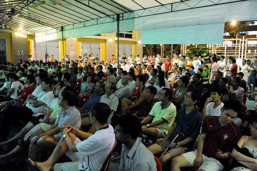 Football fans watching a World Cup match being screened live at Braddell Heights Community Club (CC). Football fans in Singapore have received a timely boost with less than a month to go before next month's World Cup.-- ST FILE PHOTO:&nbs