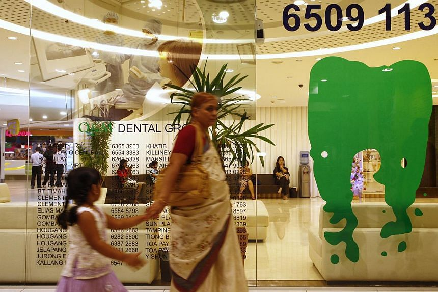 Q&M dental clinic located in the City Square Mall on Dec 27, 2012. Q&M Dental Group said on Wednesday its net profit for the first quarter ended March 31 rose 37 per cent from a year ago to $1.5 million. -- ST FILE PHOTO