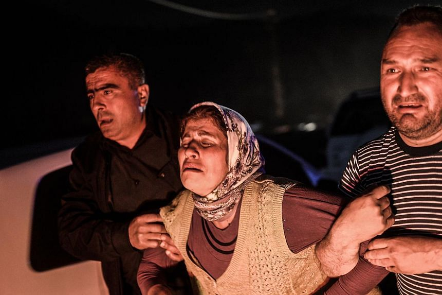 People cry after their relatives died in an explosion in Manisa on May 13, 2014. Turkey has declared three days of national mourning after more than 200 people were killed in an explosion at a coal mine, one of Turkey's worst industrial disasters, th
