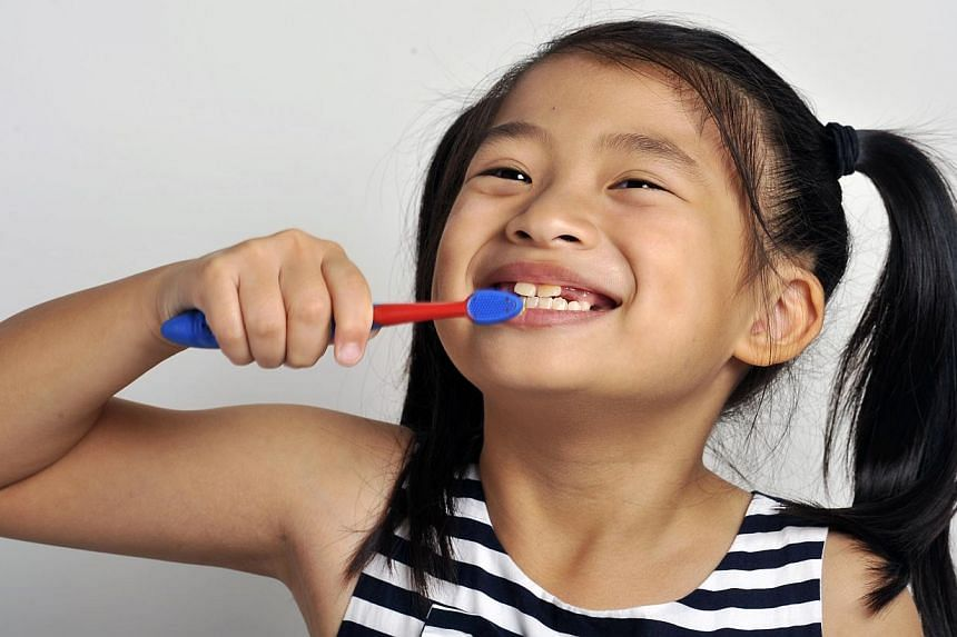More than half of all children in Singapore have one or more rotten teeth by the time they start primary school. -- ST FILE PHOTO: EDWARD TEO