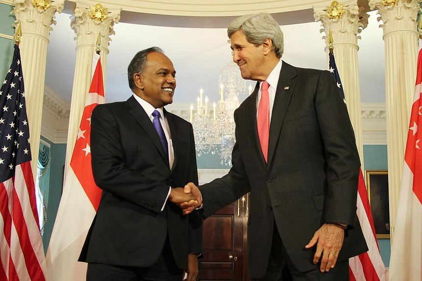 Foreign Minister K. Shanmugam (left) and US Secretary of State John Kerry meeting at the State Department in Washington on May 12, 2014. -- PHOTO: MFA