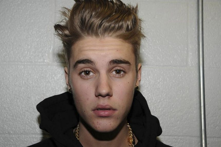 Canadian pop singer Justin Bieber is pictured in police custody in Miami Beach, Florida January 23, 2014 in this Miami Beach Police Department handout released to Reuters on March 4, 2014. The 20-year-old Canadian pop star has long entered infam