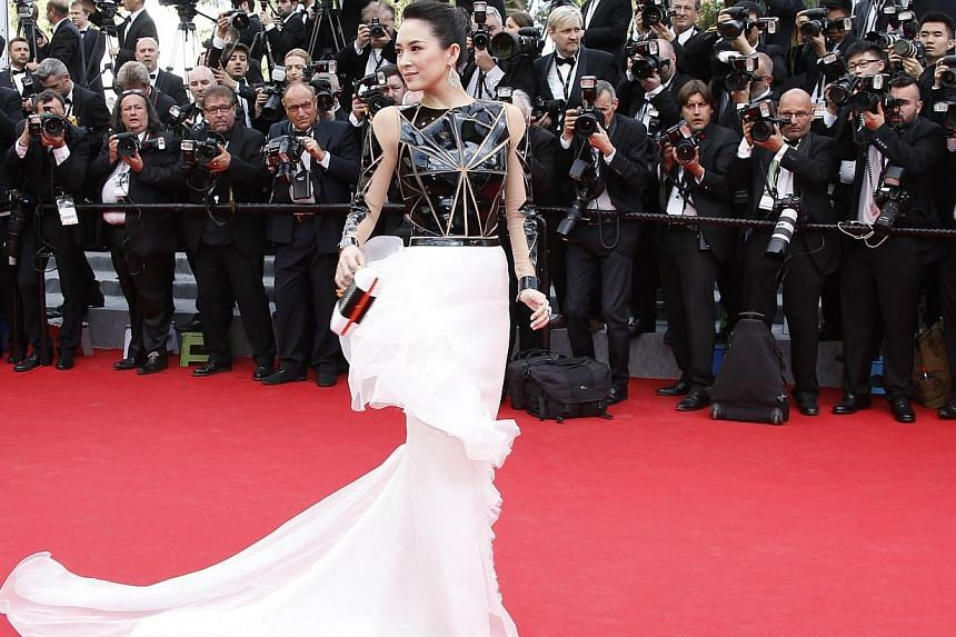 Zhang Ziyi, in a geometric, cascading Stephane Rolland dress, is ready to rock a space-age opera. -- PHOTO: AFP