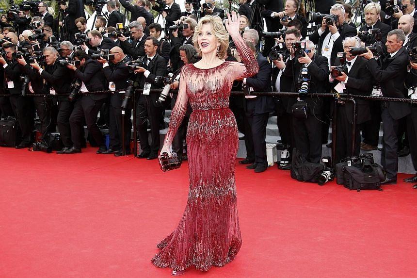 Jane Fonda brings back va-va-voom in a beaded, cinched-waist red Elie Saab dress. -- PHOTO: AFP