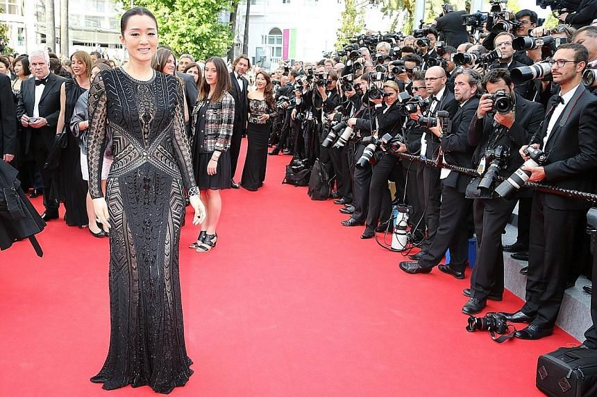 Dear Gong Li, Roberto Cavalli is not your friend. Not when he dressed you in such a mumsy black gown. -- PHOTO: AFP