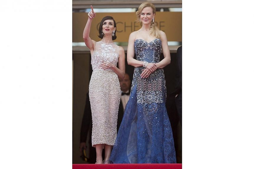 Nicole Kidman and Paz Vega sparkle at the opening of Cannes on Wednesday. Kidman is a princess out of Disney's Frozen in an intricate, jewelled blue Armani dress, crowning the look with a Elsa-worthy side braid. Vega is in a beaded white Elie Saab
