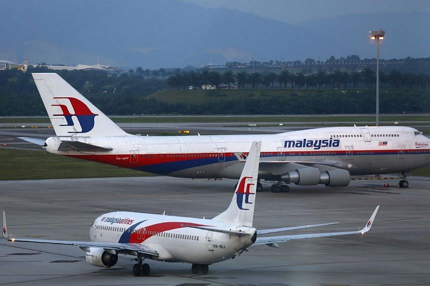 Malaysia Airlines aircrafts taxi on the runway at Kuala Lumpur International Airport in Sepang outside Kuala Lumpur May 13, 2014. Malaysia Airlines said one of its planes was grounded on Thursday, May 15, 2014, after a service vehicle struck the