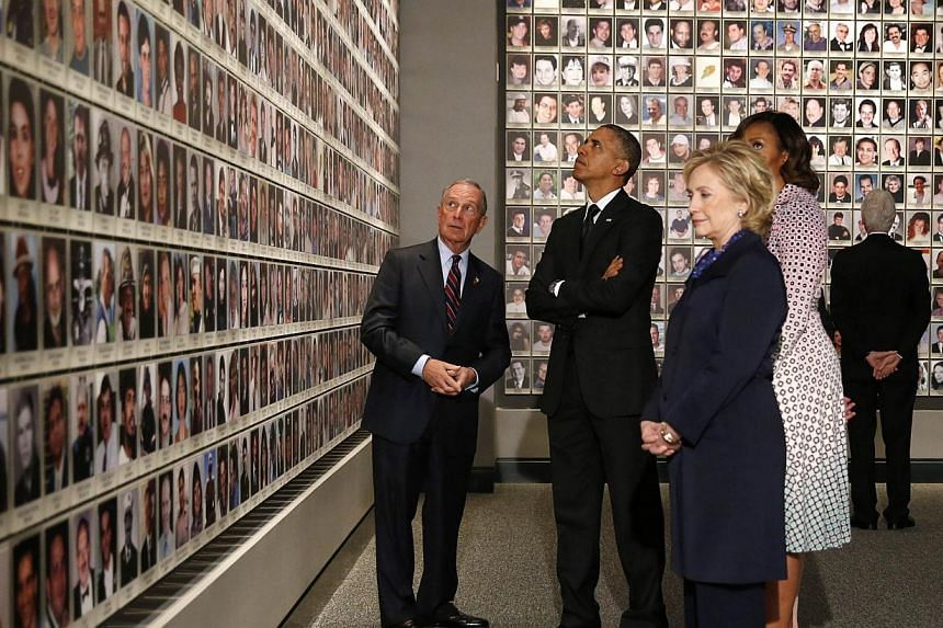 United States President Barack Obama (second left), former New York Mayor Michael Bloomberg (left), First Lady Michelle Obama (second right), former US President Bill Clinton (right) and his wife, former Secretary of State Hillary Clinton look at the