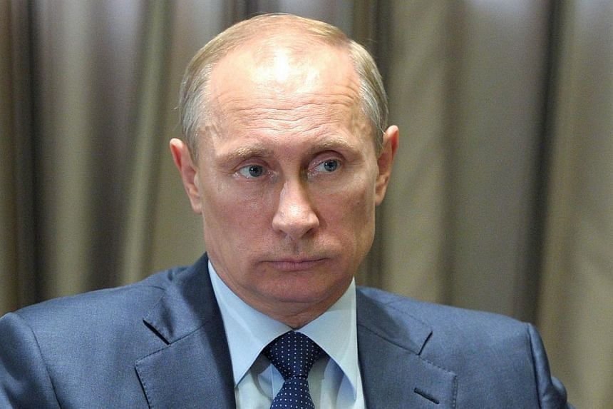 Russia's President Vladimir Putin attends a meeting at the Bocharov Ruchei residence in Sochi, on May 13, 2014.Russian President Vladimir Putin, his popularity driven up by the crisis in Ukraine, is firmly on course to win a new term in 2018 if