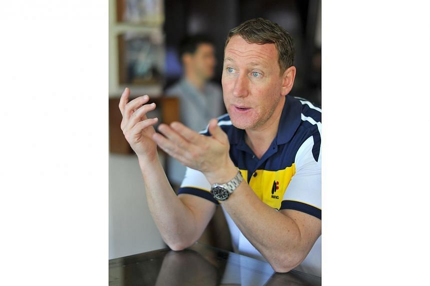Arsenal legend Ray Parlour believes England should play for a draw in their opening World Cup group match against Italy on June 14. -- ST PHOTO: LIM YAOHUI FOR THE STRAITS TIMES