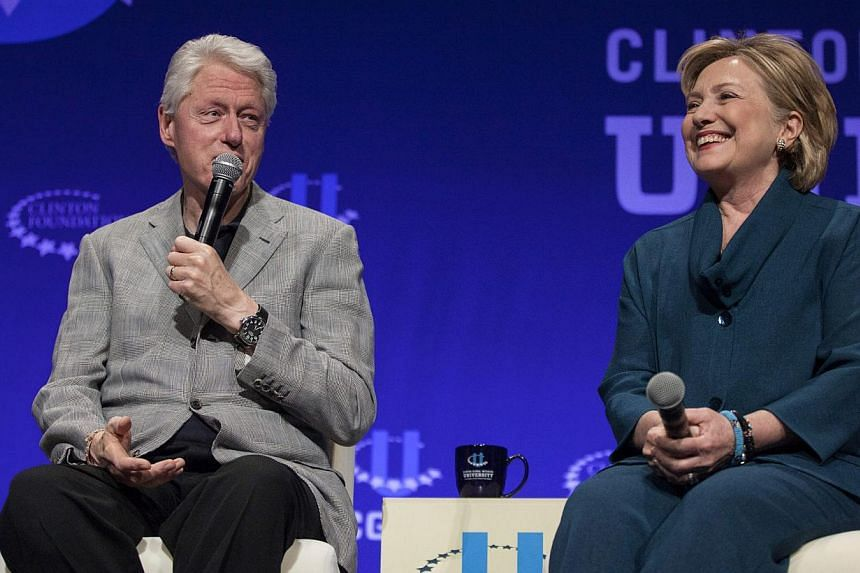 Former President Bill Clinton (left) and former Secretary of State Hillary Clinton discuss how they first were involved in politics during the second day of the 2014 Meeting of the Clinton Global Initiative at Arizona State University in Tempe on Mar