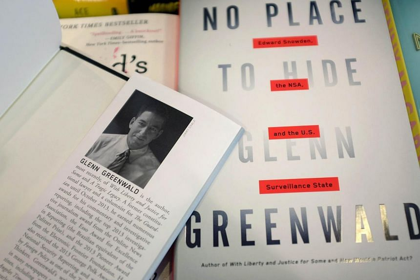 """Glenn Greenwalds new book, """"No Place to Hide,"""" is seen at a book store on May 13, 2014 in Miami, Florida. The book written by Greenwald is about former National Security Agency contractor Edward Snowden. -- FILE PHOTO: AFP"""