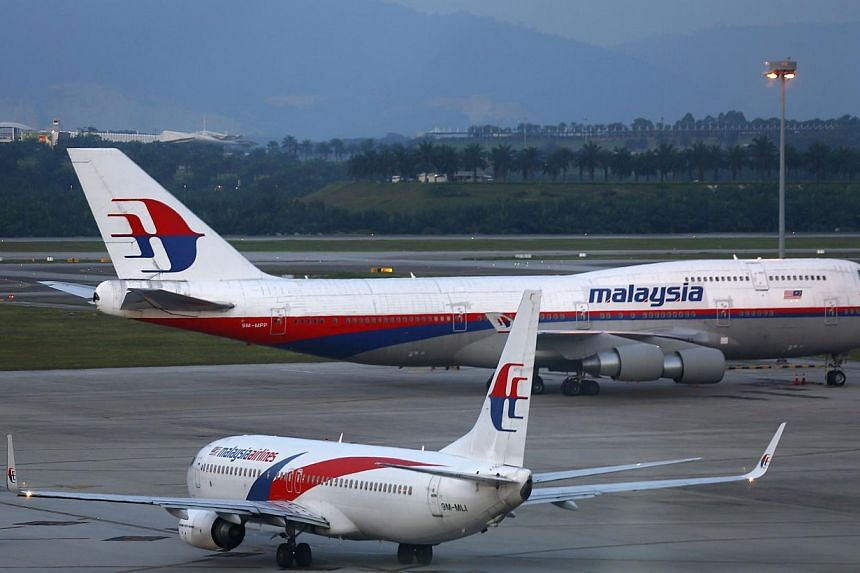 Malaysia Airlines will report first-quarter earnings later on Thursday that are set to provide confirmation of just how badly the already loss-making carrier's finances have been hit by the vanishing of flight MH370 on March 8. -- PHOTO: REUTERS