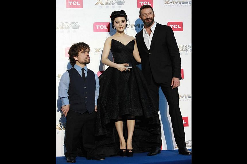 X-Men: Days Of Future Past cast (from far left) Peter Dinklage, Fan Bingbing and Hugh Jackman at the movie premiere in Beijing. -- PHOTO: TWENTIETH CENTURY FOX
