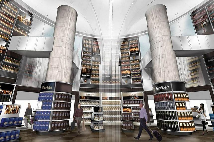 An artist's impression of a DFS shop to be opened at Changi's T3. The terminal will also boast a members-only lounge and a Long Bar - concepts that have not been seen before at other airports, says DFS. -- PHOTO: CHANGI AIRPORT GROUP