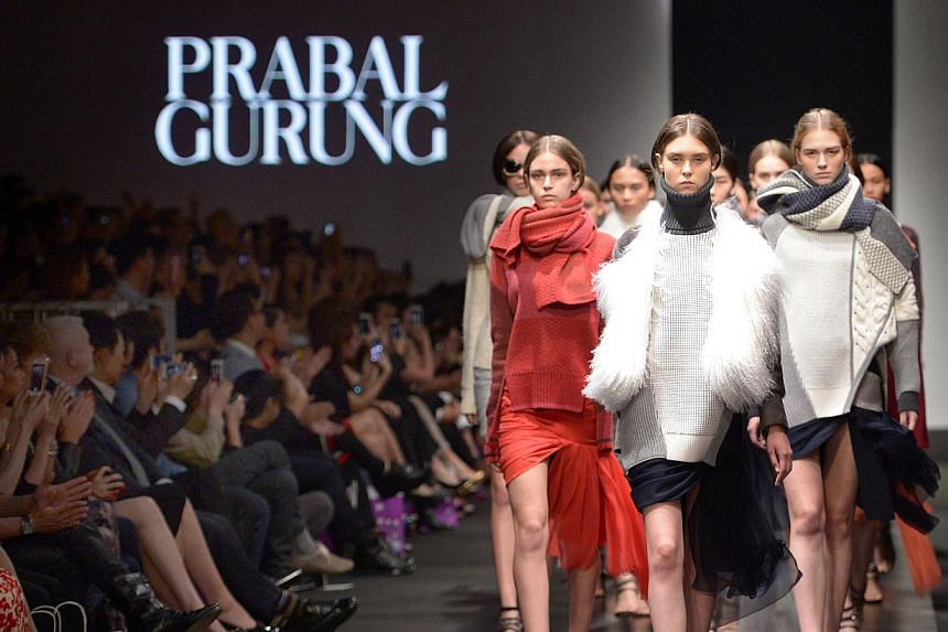 Models showing off the fall 2014 collection from Nepalese-American designer Prabal Gurung (right), which was inspired by the Mustang region in Nepal, at the Audi Fashion Festival last night.